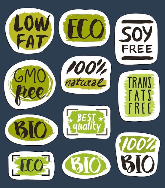 Biologisch voedsel hand getekende etiketten set Premium Vector