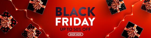 Black friday-uitverkoop 50% korting op poster met geschenkdoos en led-lichtslingers voor detailhandel Premium Vector