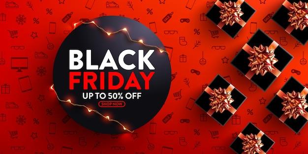 Black friday-uitverkoop 50% korting op poster met led-lichtslingers voor detailhandel, winkelen of black friday-promotie in rode en zwarte stijl Premium Vector