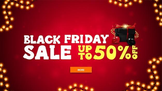 Black friday-uitverkoop, tot 50% korting, heldere horizontale kortingsbanner in cartoonstijl met rode onscherpe achtergrond, groot aanbod, knop, slinger en zwarte cadeautjes versierd met slinger en ballonnen Premium Vector
