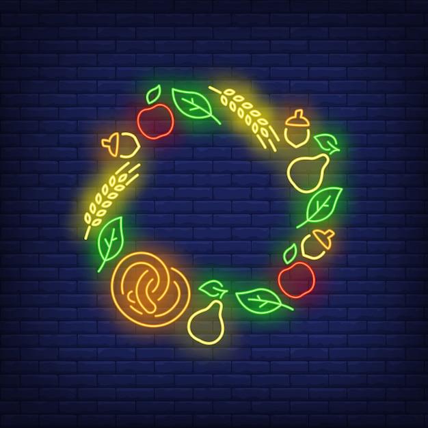 Bladeren, appels, eikels, peren, krakeling en oren omlijsten neonreclame Gratis Vector