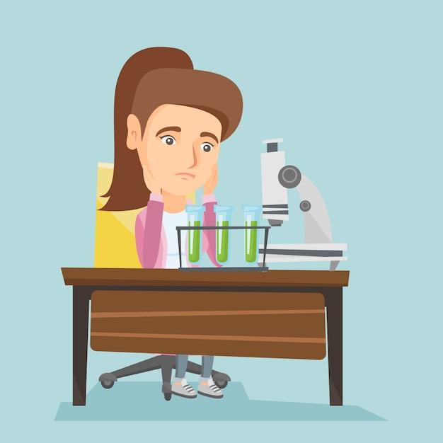 Blanke student werkt in laboratoriumklasse. Premium Vector