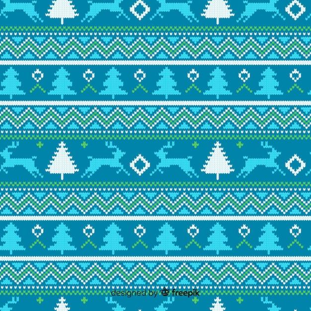 Blauw gebreid kerstpatroon Gratis Vector