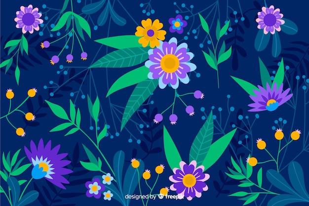 Blauwe achtergrond met paarse en gele bloemen Gratis Vector