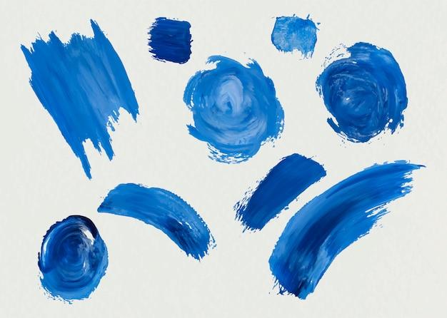 Blauwe acrylverf penseelstreken Gratis Vector