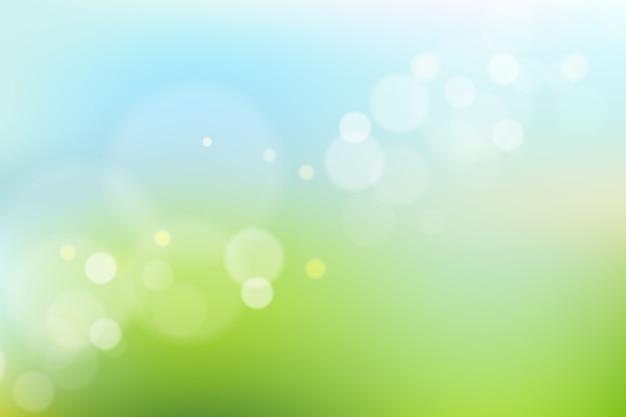 Blauwe en groene achtergrond met kleurovergang met bokeh-effect Gratis Vector