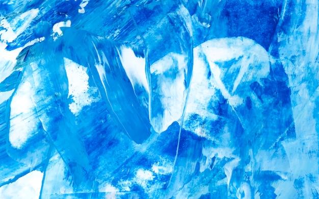 Blauwe en witte abstracte acryl penseelstreek gestructureerde achtergrond Gratis Vector