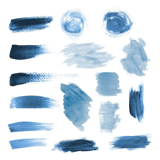 Blauwe grunge penseelstreek ontwerp vector set Gratis Vector