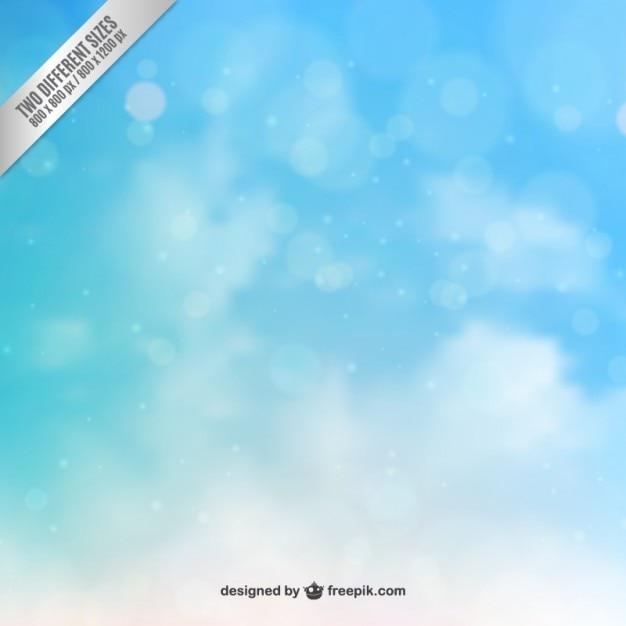 Blauwe hemel in bokeh stijl Gratis Vector
