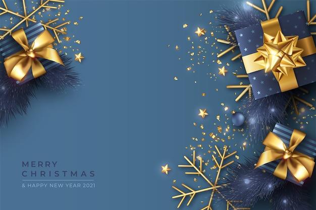 Blauwe kerst achtergrond met realistische cadeautjes en ornamenten Gratis Vector