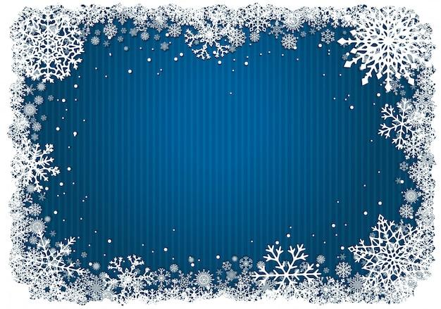 Blauwe kerstmisachtergrond met kader van sneeuwvlokken Premium Vector