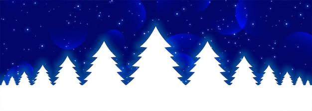 Blauwe kerstmisbanner met witte gloeiende kerstmisbomen Gratis Vector