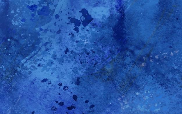 Blauwe vlekken en druppels in aquarel Gratis Vector