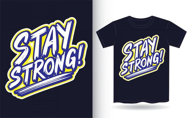 Blijf sterk handschrift slogan voor t-shirt Premium Vector