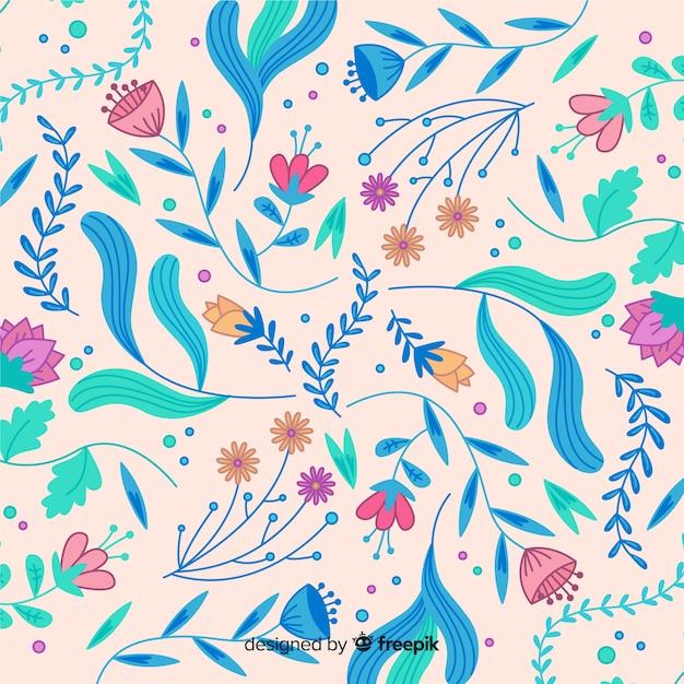 Bloeiende handgetekende bloemenachtergrond Gratis Vector