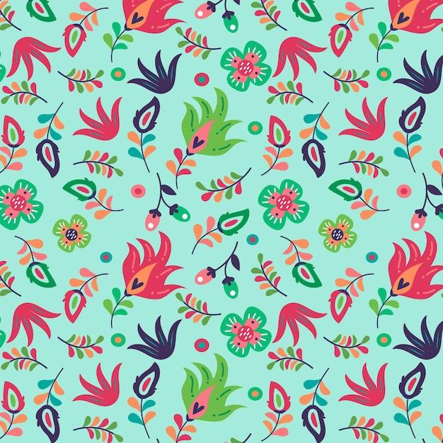Bloeiende lentebloemen op stoffenpatroon Gratis Vector