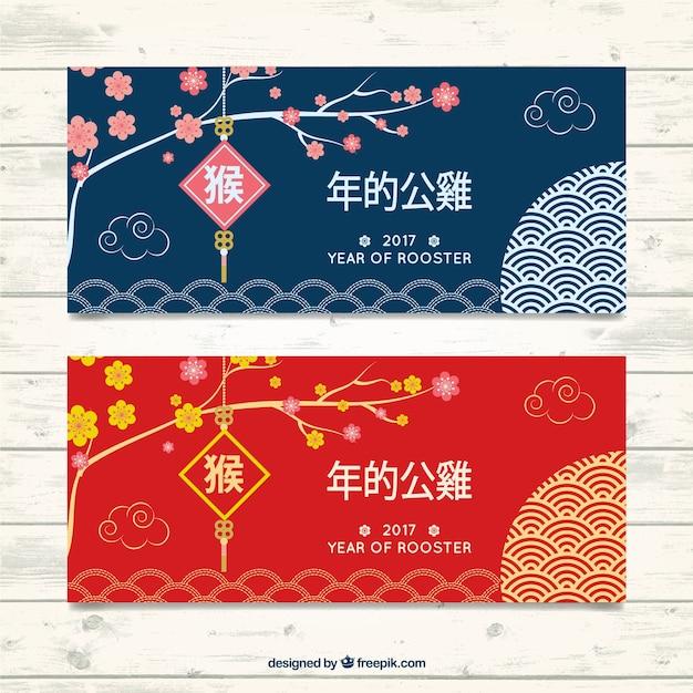 Bloemen banners voor Chinees Nieuwjaar Gratis Vector