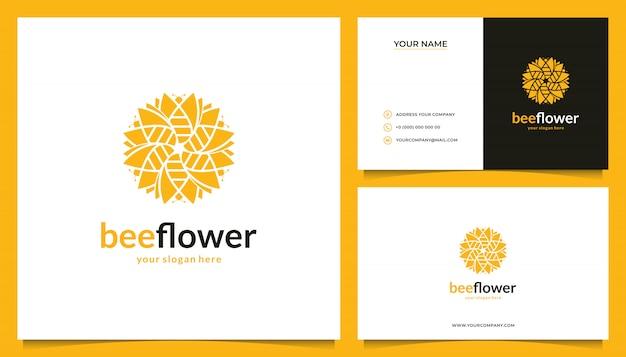 Bloemlogo ontwerp met een combinatie van bijen en visitekaartjes Premium Vector