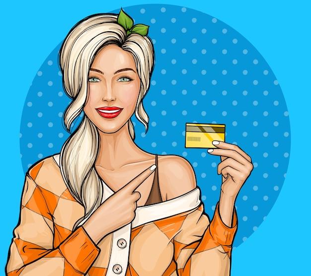 Blond meisje met plastic creditcard in de hand in pop-art stijl Gratis Vector