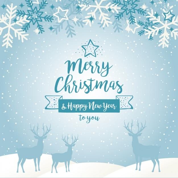 Blue christmas achtergrond met silhouetten van rendieren en sneeuwvlokken Gratis Vector