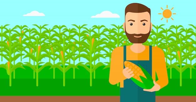 Boer bedrijf maïs. Premium Vector