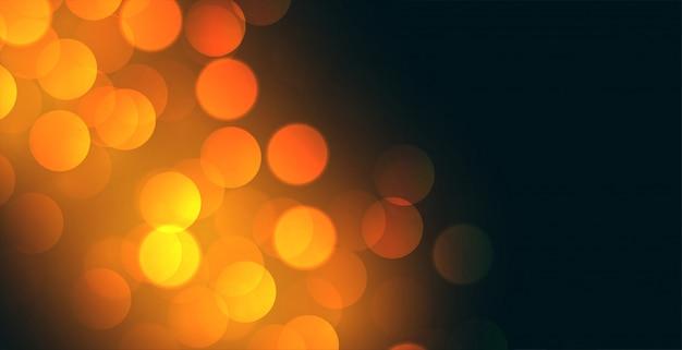 Bokeh achtergrondontwerp met geel lichteffect Gratis Vector