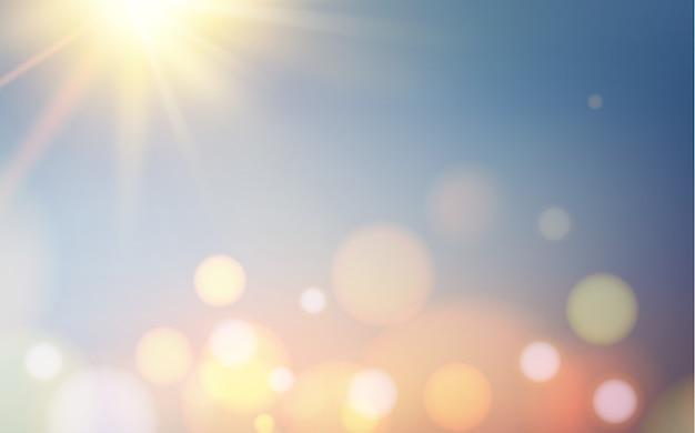 Bokehbellen en zon flitsen over blauwe achtergrond Gratis Vector