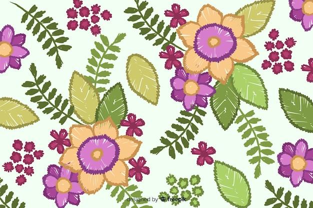 Borduurwerk bloemenachtergrond Gratis Vector