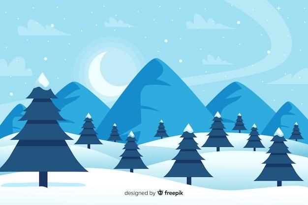 Bos van kerstbomen en bergen in de winter Gratis Vector
