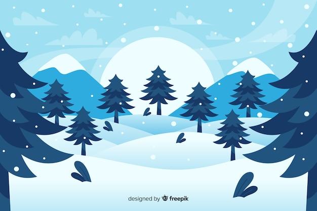 Bos van kerstbomen en bergen plat ontwerp Gratis Vector