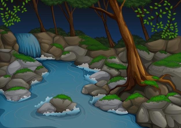 Bosscène met waterval en bomen bij nacht Premium Vector