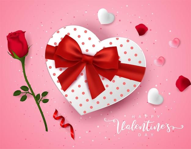 Bovenaanzicht op liefde geschenkdoos en en rose bloem. Premium Vector
