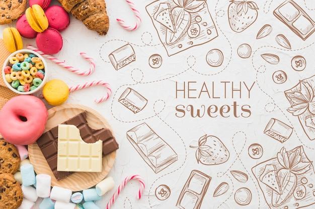 Bovenaanzicht selectie van snoep en gebak Gratis Vector