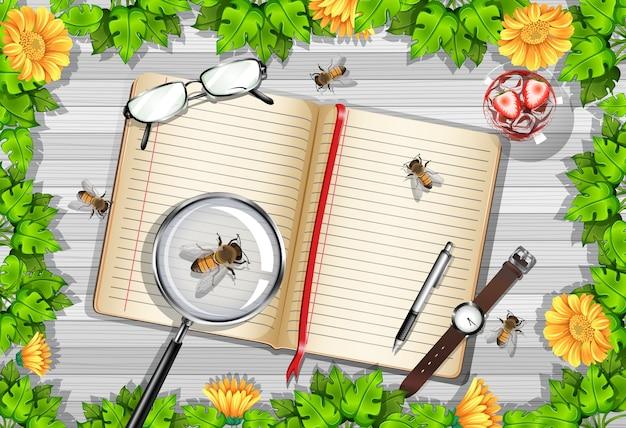 Bovenaanzicht van houten tafel met kantoorobjecten en bladeren en insecten-element Gratis Vector