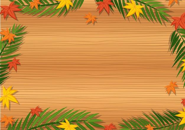 Bovenaanzicht van lege houten tafel met bladeren in verschillende seizoenelementen Gratis Vector
