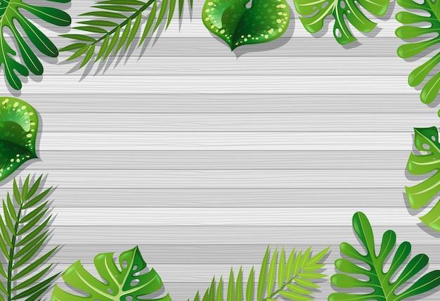 Bovenaanzicht van lege houten tafel met elementen van de bladeren Gratis Vector