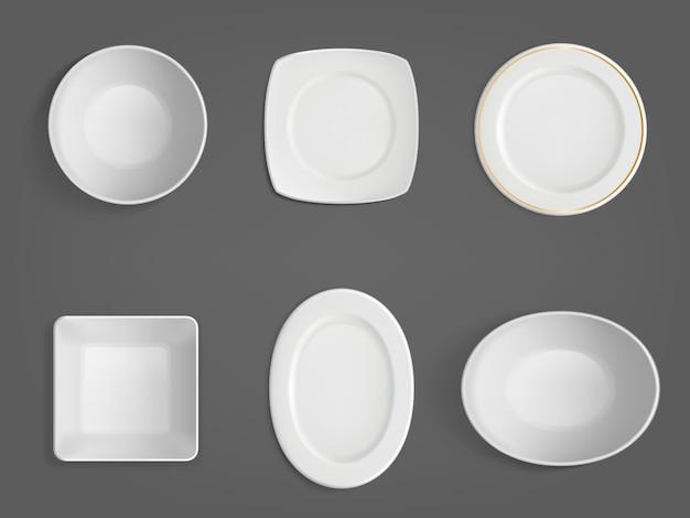 Bovenaanzicht van witte verschillende vormen kommen Gratis Vector