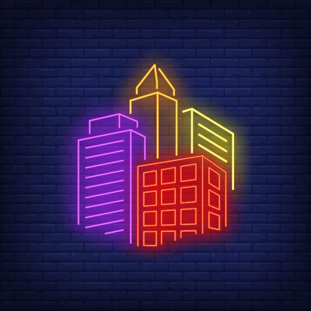 Bright stad gebouwen neon sign. Gratis Vector