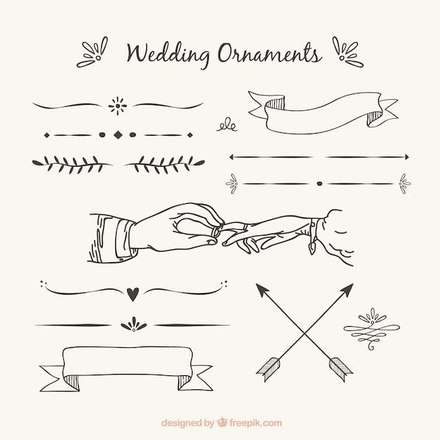 Bruiloft ornamenten met handgetekende stijl Gratis Vector