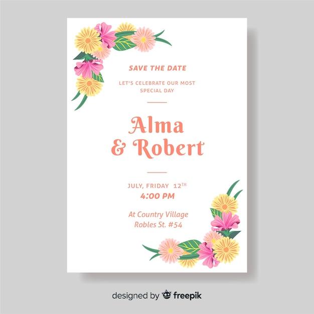 Bruiloft uitnodiging sjabloon met bloemen Gratis Vector
