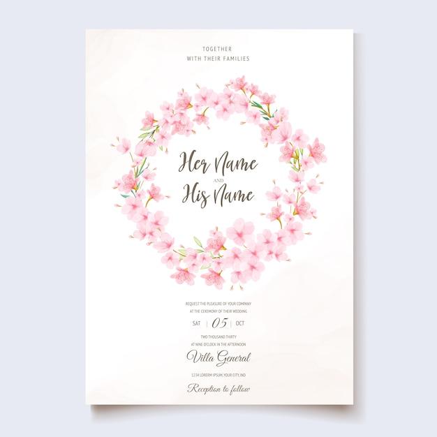 Bruiloft uitnodiging sjabloon met kersenbloesem krans Gratis Vector