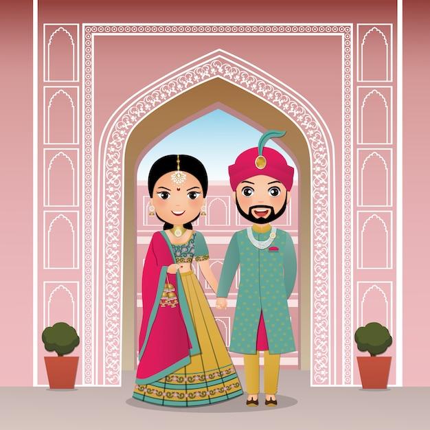 Bruiloft uitnodigingskaart de bruid en bruidegom schattig paar in traditionele indiase jurk stripfiguur Premium Vector
