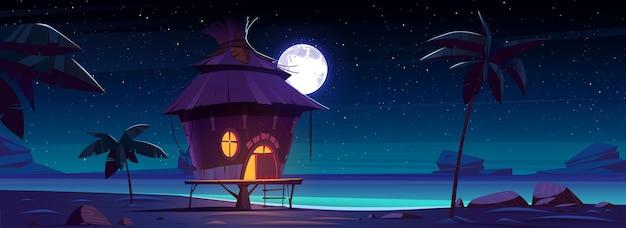 Bungalow 's nachts op tropisch eiland Gratis Vector