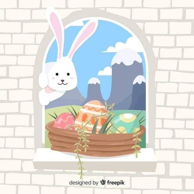 Bunny die uit venster pasen-dagachtergrond piepen Gratis Vector