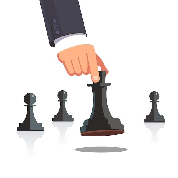 Business man hand maken een strategische schaakbeweging Gratis Vector