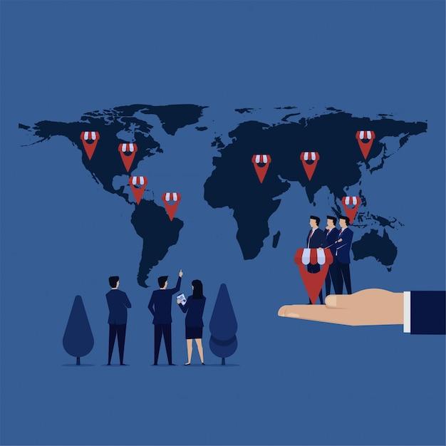 Business team zet franchise pictogram gps op kaart voor uitbreiding van het bedrijf. Premium Vector