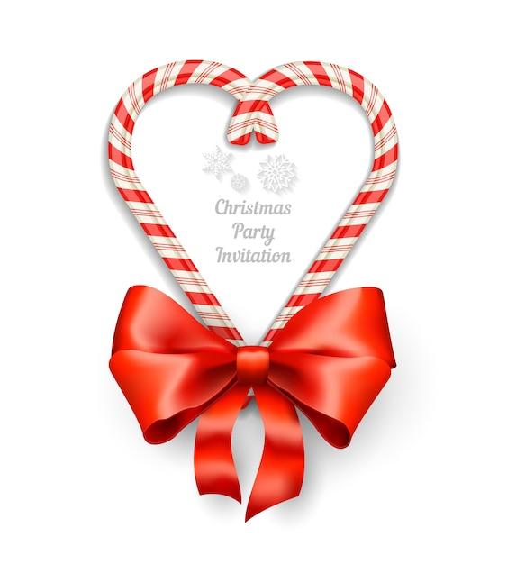 Candy canes in hartvorm frame met tekst voor kerst uitnodiging Gratis Vector