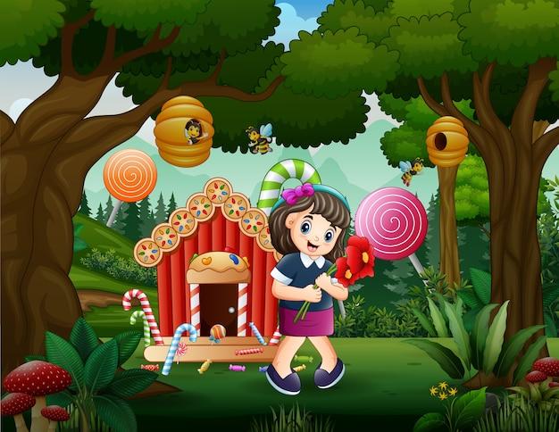 Candy land achtergrond met een meisje met bloemen Premium Vector