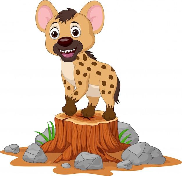 Cartoon baby hyena op boomstronk Premium Vector