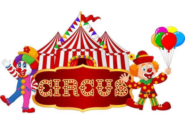 Cartoon gelukkige clowns met tent achtergrond Premium Vector